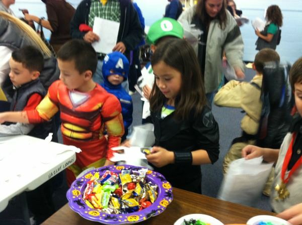 Kids Getting Candy from a Bowl