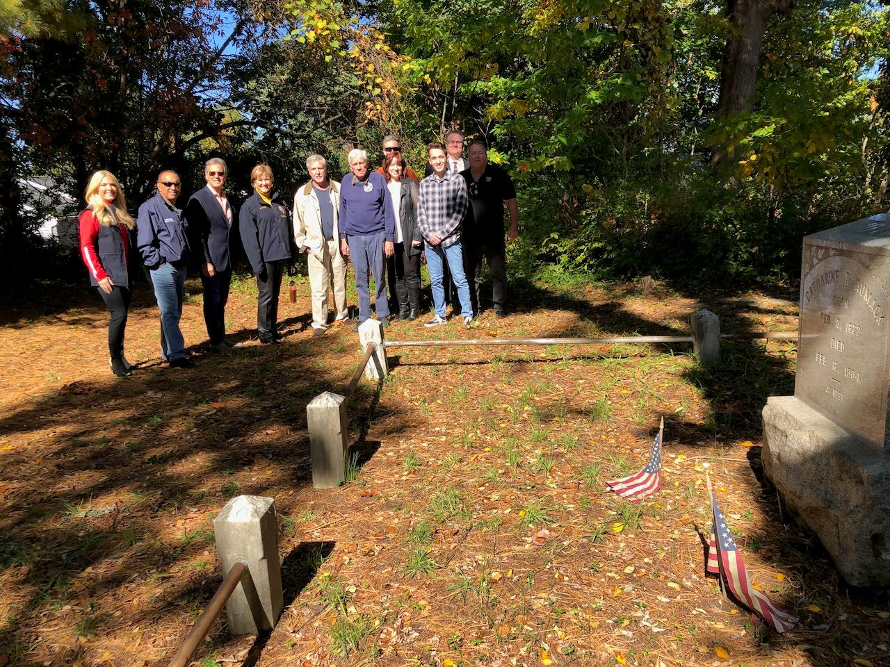 County and Hazlet officials visit the Aumack Cemetery and meet the family